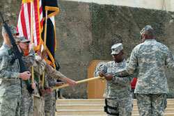 U.S. Army officers retire the U.S. military's ceremonial flag