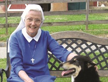 Bella the dog with a sister from the Sisters of Jesus Our Hope in New Jersey
